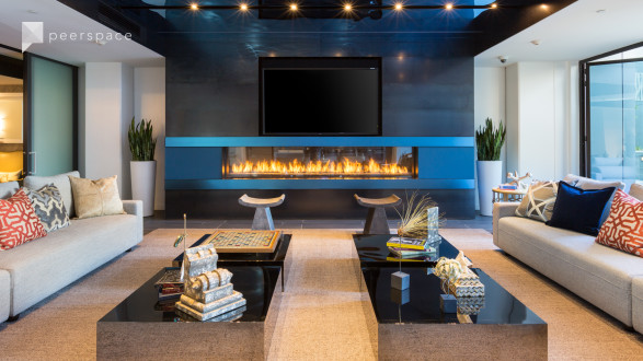 Spacious, modern lounge with fireplace and attached kitchen in Mission Bay, San Francisco, CA | Peerspace
