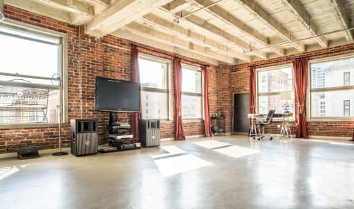 Charismatic Corner Loft Studios with Incredible Light, City Views and a Balcony in Central LA, Los Angeles, CA | Peerspace