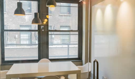 Bright conference room perfect for small groups in Midtown, New York, NY | Peerspace
