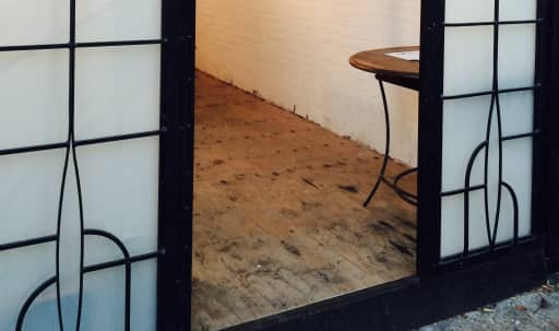 Vintage Iron and Glass Storefront Art Gallery in Bushwick, Brooklyn, NY | Peerspace