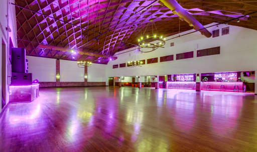 16,000 sq. ft venue with 40 feet high diamond shaped wood ceilings. The perfect space for your wedding, banquet, or celebration. Miracle Mile location with incredible art deco design. in Central LA, Los Angeles, CA | Peerspace