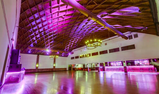 16,000 sq. ft venue with 40 foot high diamond shaped wood ceilings. The perfect space for your wedding, banquet, or celebration. Miracle Mile location with incredible art deco design. in Central LA, Los Angeles, CA | Peerspace