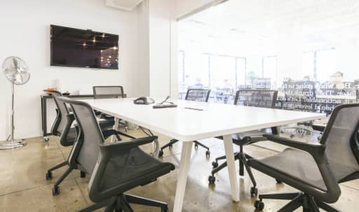 8-10 person conference room within bright, modern coworking space. in Midtown, New York, NY | Peerspace