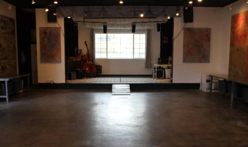 Westside Indoor/Outdoor Event Space with a stage, tall ceilings, and outdoor lounge. in Central LA, Los Angeles, CA | Peerspace