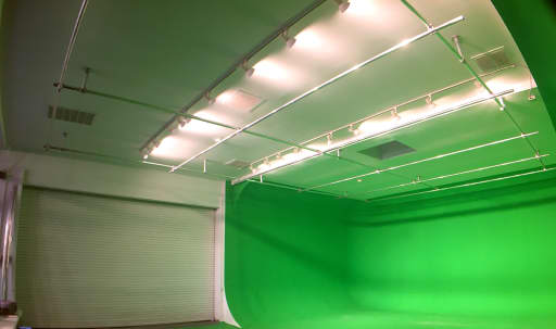 Huge 235º+ Green Screen with roll-up garage for vehicle access in Central LA, Los Angeles, CA | Peerspace