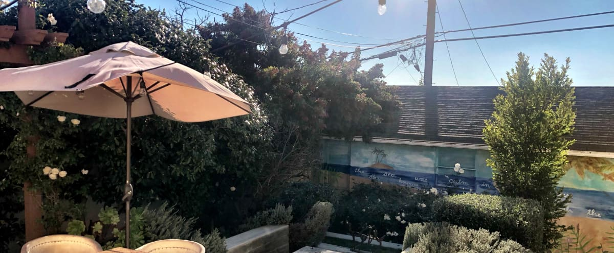 Lush, Gorgeous Backyard with Firepit, Couch Swing, Mural and Little Water Fountain in Los Angeles Hero Image in Mar Vista, Los Angeles, CA