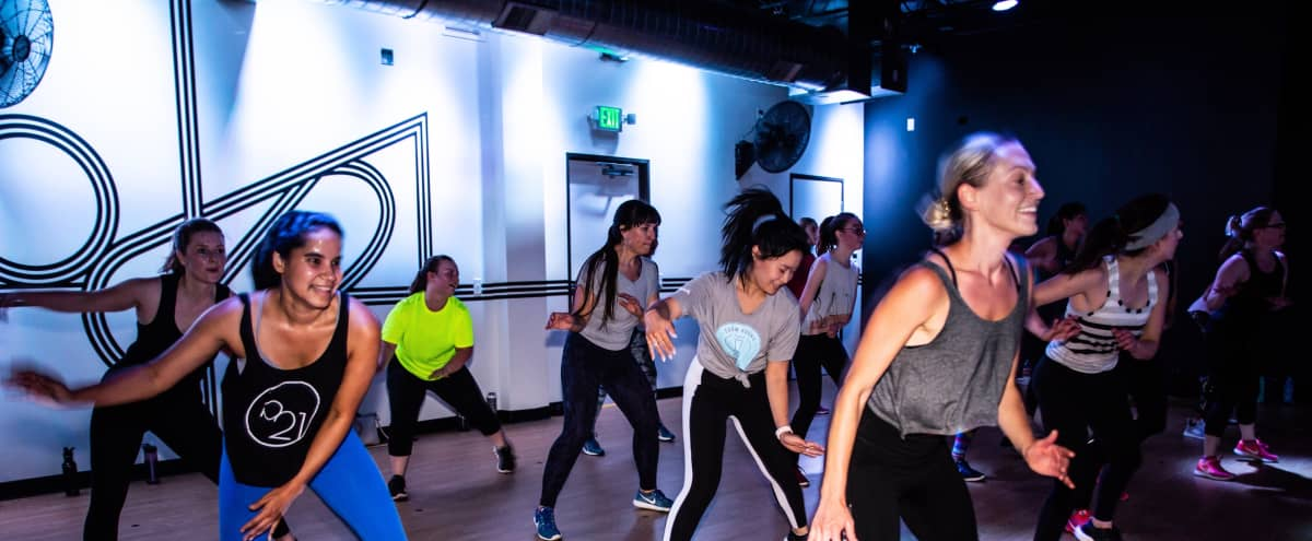 Trendy Boutique Fitness Studio with Nightclub Lighting For Fitness Photoshoots and Videos in Denver Hero Image in Capitol Hill, Denver, CO