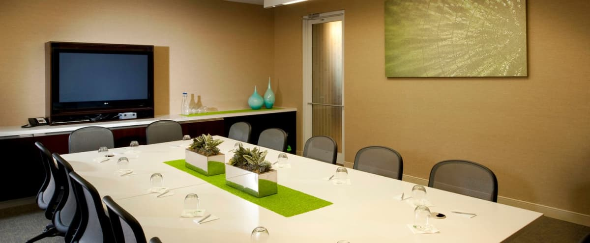 Spacious Boardroom Equipped with Technology and Beverage Station | Near DFW Airport in Irving Hero Image in Las Colinas, Irving, TX