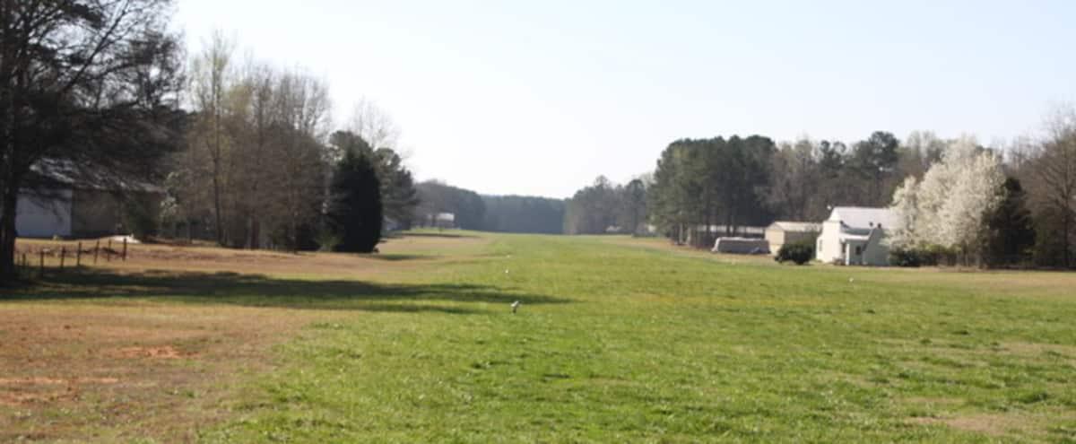 Private runway grass landing strip w/ airplane hanger in Luthersville Hero Image in undefined, Luthersville, GA