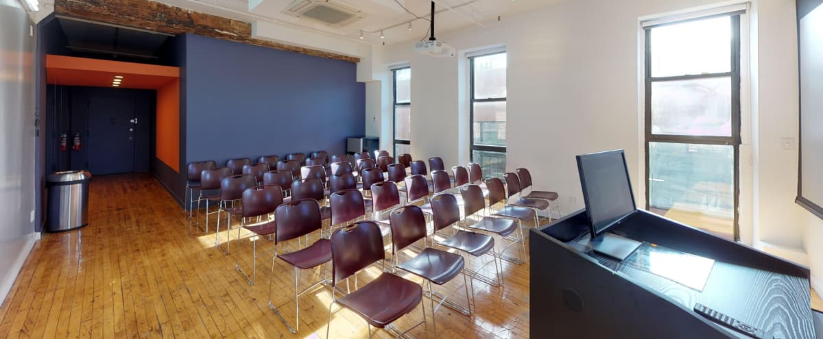 Classroom/Meetings/Conference Room with:  Projector/Screen, Tables/Chairs, 10' x 20' Dry Erase Magnetic Board, Lectern/Computer/Speakers, Fridge, Black Out Blinds, Adjustable Mitsubishi HVAC, Adjustable Track Lighting, Brilliant Light in Brooklyn Hero Image in Greenpoint, Brooklyn, NY
