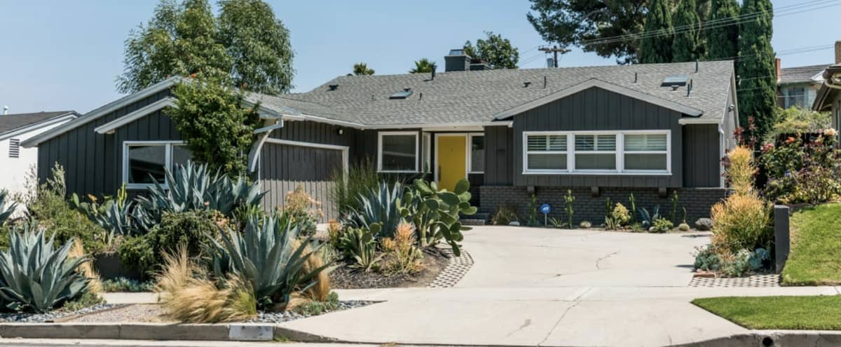 Mid Century Ranch with vaulted ceilings, big backyard, fire pit and pool. in Los Angeles Hero Image in South Los Angeles, Los Angeles, CA