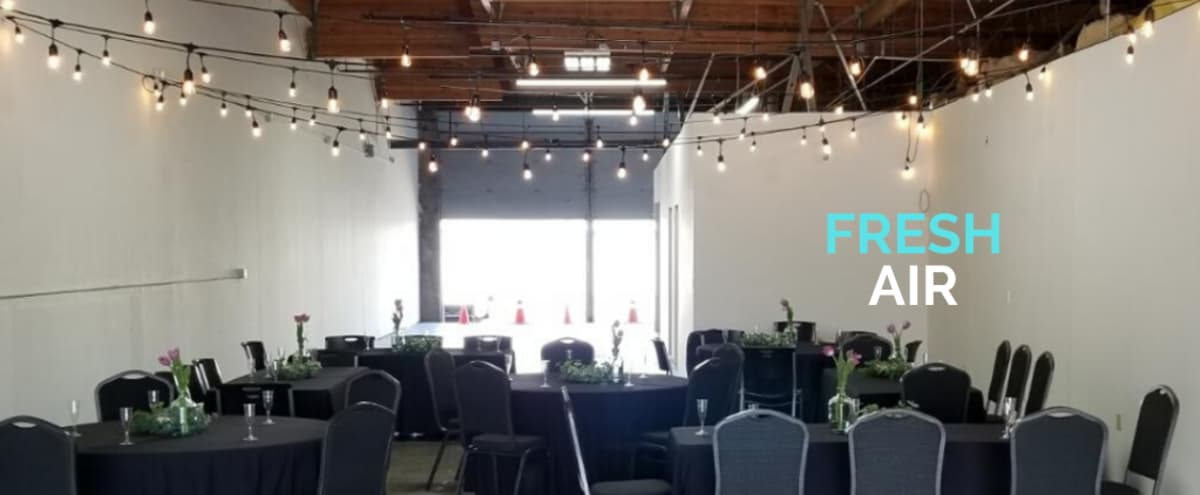 The Breeze is an industrial event venue open at both ends with fresh air flow and indoor comfort & amenities. in Woodinville Hero Image in North Industrial, Woodinville, WA