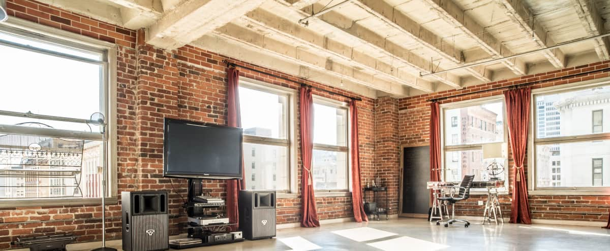 Charismatic Corner Loft Studios with Incredible Light, City Views and a Balcony in Los Angeles Hero Image in Downtown, Los Angeles, CA