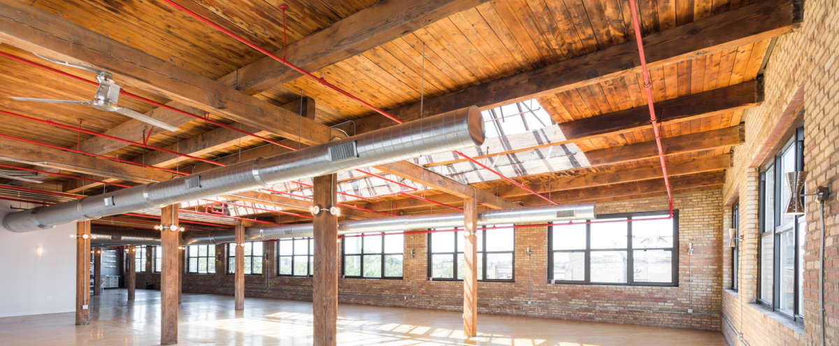 Historic, beautiful brick & timber industrial loft with breath-taking skyline views and natural light in Chicago Hero Image in West Town, Chicago, IL