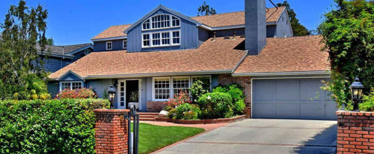 East Coast Traditional Gated Home with Pool & Lush Backyard in Studio City Hero Image in Studio City, Studio City, CA