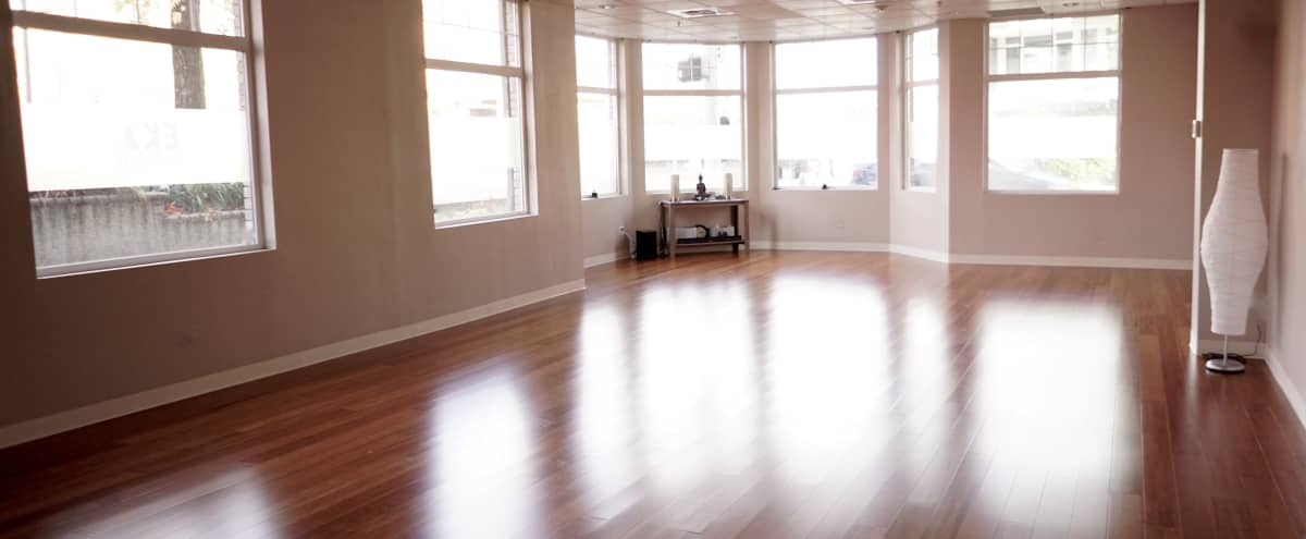 Warm, Welcoming, and Naturally Lit Yoga Studio with Bamboo Floors in Seattle Hero Image in Queen Anne, Seattle, WA