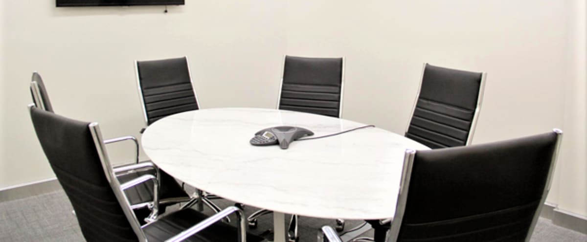 Professional Medium Meeting Room B for 6 - HS (Spring Promo) in New York Hero Image in Midtown, New York, NY