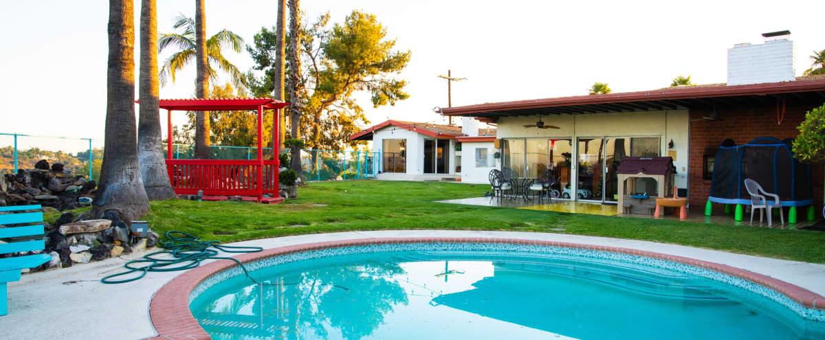 Huge Backyard with Pool, Bridge, Waterfall, Koi Fish pond, and a 1970s vibe. in Los Angeles Hero Image in Northeast Los Angeles, Los Angeles, CA