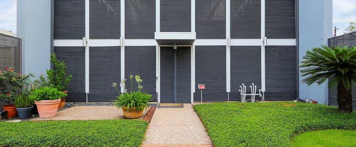 Light Filled Modern Glass & Steel Townhouse in Houston Hero Image in Braeswood Place, Houston, TX