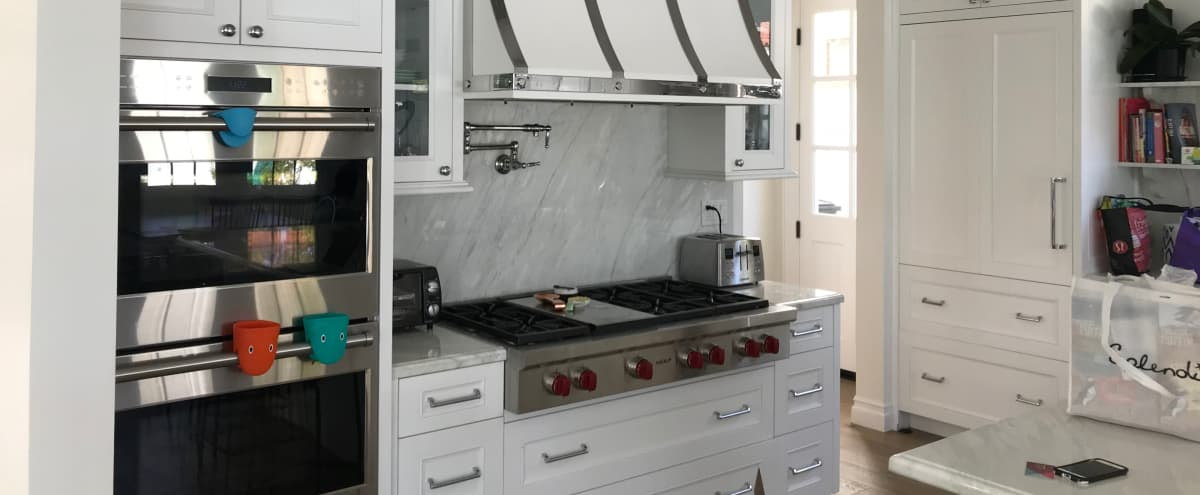 Transitional Traditional White Kitchen with White Marble Wolf and SubZero Appliances in Santa Monica Hero Image in Northeast, Santa Monica, CA