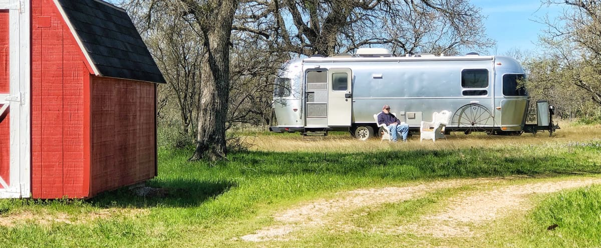 COUNTRY FARM, Large House, Natural Light..Airstream on site.. Wildflowers in Season! Indoor-Outdoor SPACE!...Authentic Hill Country Setting in Marble Falls Hero Image in Downtown Austin, Marble Falls, TX