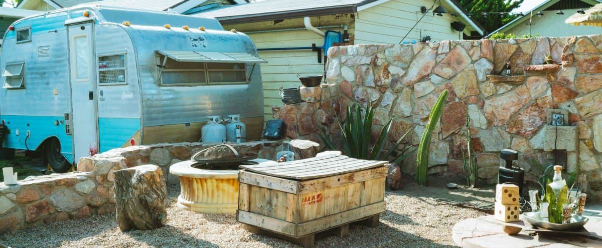 Vintage Backyard Stone Cantina, Trailer, and Firepit in long beach Hero Image in Rose Park, long beach, CA