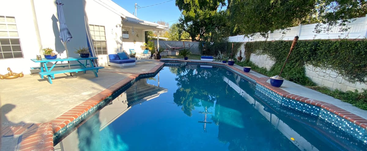 Large House, 1000SF living room, with Spacious Backyard & Pool Perfect for Filming (Range Rover is avail too for shooting) in Woodland Hills Hero Image in Woodland Hills, Woodland Hills, CA