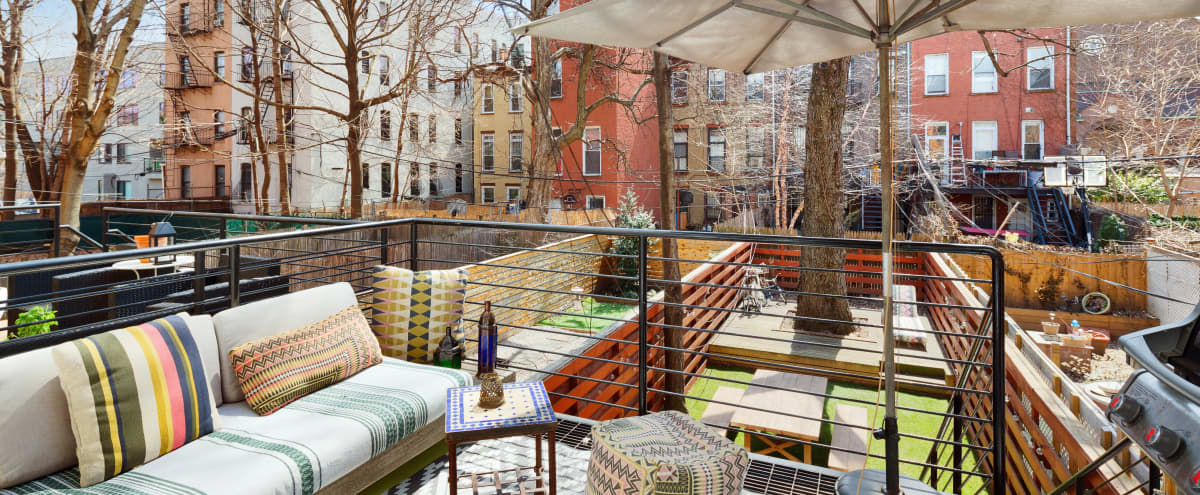 2,800 sq./ft. vivacious bohême 4-story brownstone with 1,000 sq./ft. outdoor retreat in Clinton Hill in Brooklyn Hero Image in Bedford-Stuyvesant, Brooklyn, NY