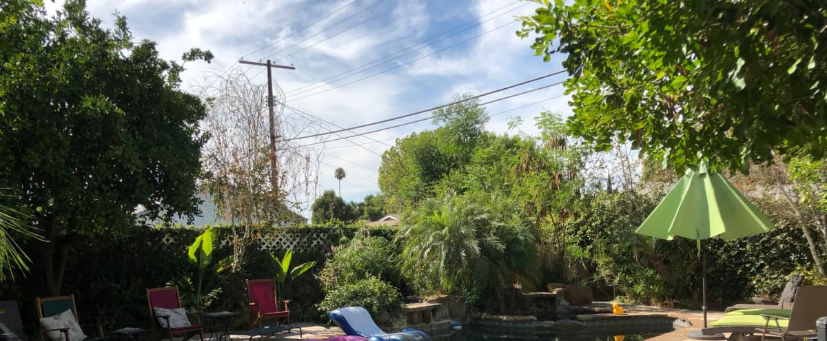 Backyard Tropical Oasis - Pool/Waterfalls/Patio/Fireplace/Wet Bar in Tarzana Hero Image in Tarzana, Tarzana, CA
