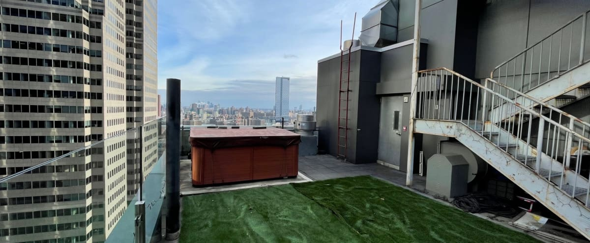 High Rooftop with Jacuzzi and Incredible Views of the River & Bridges in New York Hero Image in Financial District, New York, NY