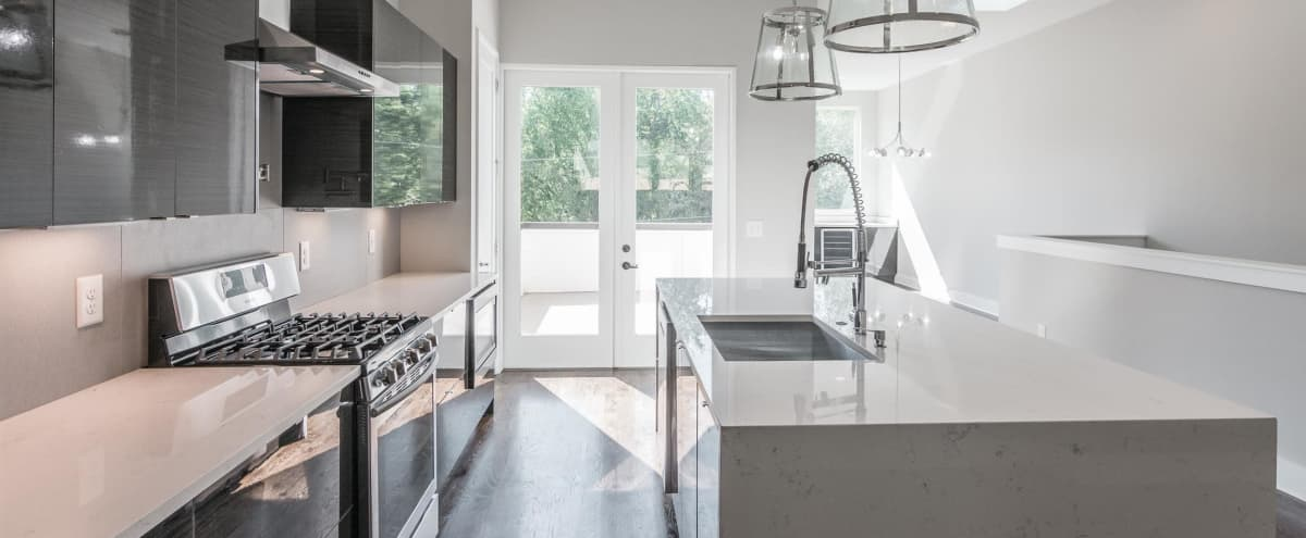 Modern Home With Trendy Decor And Outdoor Space, 12 Ft Ceilings, By Downtown Nashville And Germantown in Nashville Hero Image in Buena Vista Heights, Nashville, TN