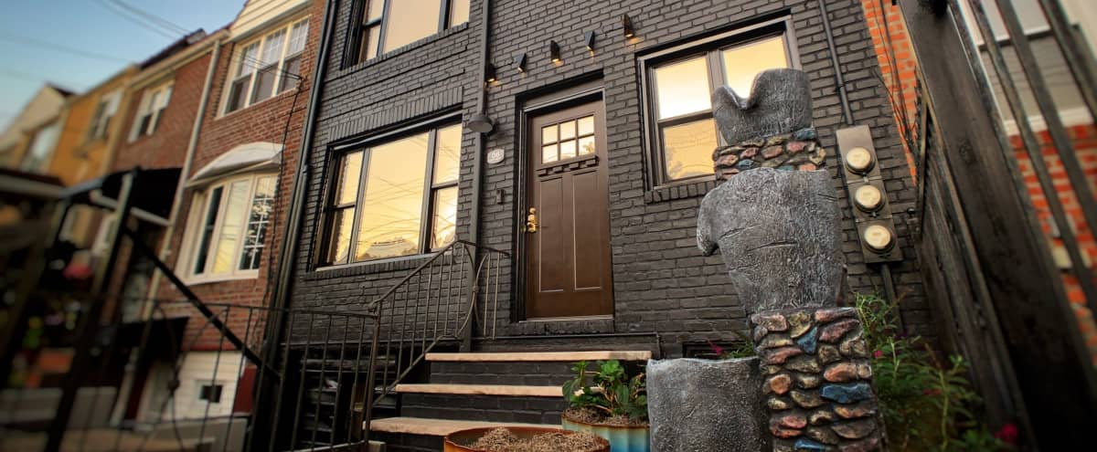 Black and Gold Townhome with White Floors. in New York Hero Image in St. Albans, New York, NY