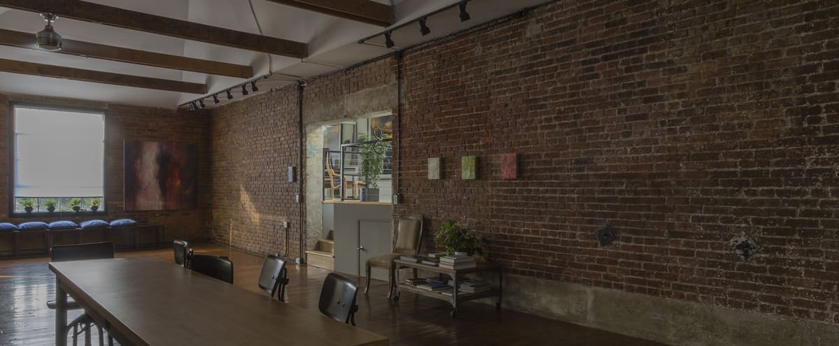 Expansive Arts District Adjacent Loft, Exposed Brick, Original Wood Floors, Private Rooftop Terrace w/ Skyline View of DTLA with freight elevator in Los Angeles Hero Image in Downtown, Los Angeles, CA
