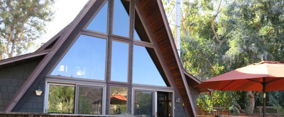 Bu House.  A 1970's Topanga Retreat with Mountain Views in Topanga Hero Image in Sylvia Park, Topanga, CA