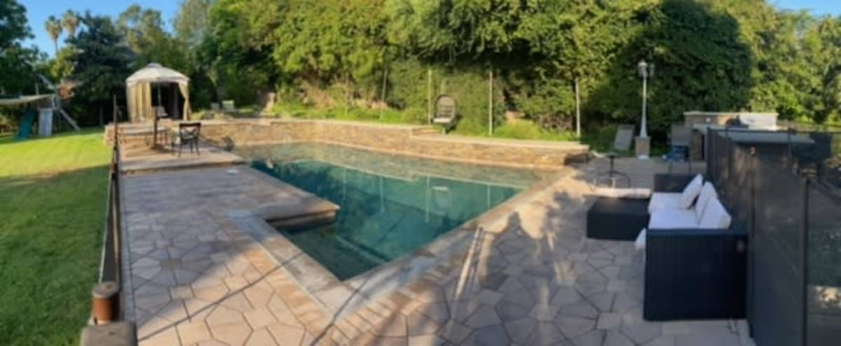 Roomy 2500sq foot property on 3/4 of an acre with waterfall pool/jacuzzi outdoor living room, cabana, bbq and bar in santa ana Hero Image in undefined, santa ana, CA