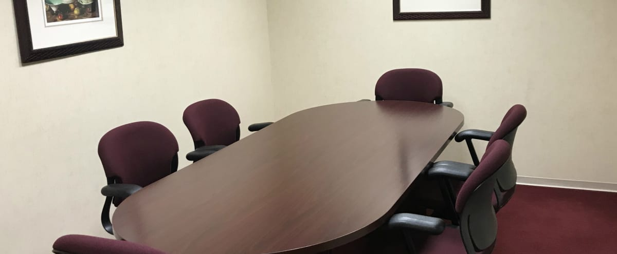 6 Person Meeting Room with Easily Accessible Oak Brook Location | Rosewood in Oak Brook Hero Image in Oak Brook, Oak Brook, IL
