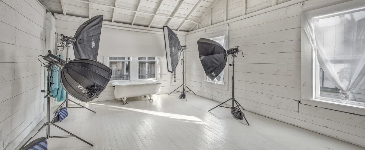 Old Town Spring Photo & Video Studio in a 100 Year Old Farm Style House in Spring Hero Image in Ribinson, Spring, TX