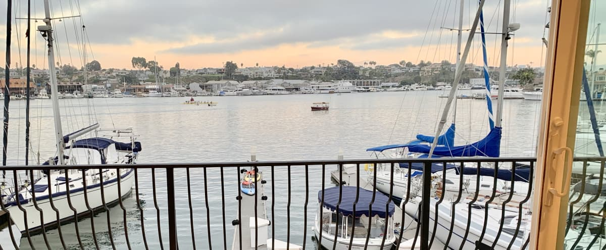 Harbor view literally on the water in a modern house with sandy beach, lots of space, jacuzzi and putting green in newport beach Hero Image in Balboa Peninsula, newport beach, CA