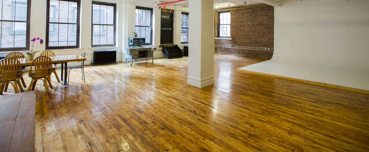 2,200 ft² Sunny Loft in NoMad with a projection wall, reclaimed wood backdrop, and exposed brick in New York Hero Image in Midtown, New York, NY