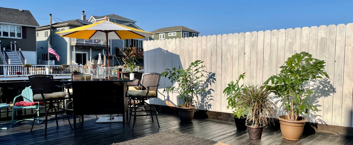 Outdoor Expansive Tropical Deck on a Canal in Broad Channel Hero Image in Broad Channel, Broad Channel, NY