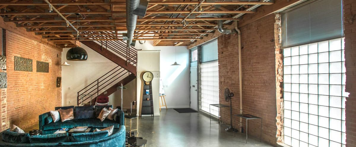 Vintage Loft, Exposed brick & Glassblock, Roof w/ Downtown View in Dallas Hero Image in Dallas Downtown Historic District, Dallas, TX