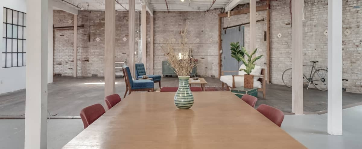 Historic 1908 Loft: 5500 sqft Photo & Film Studio. Exposed Brick walls, Natural Light, Themed Rooms, White Cyc Wall, Glam & Wardrobe Rooms, and Kitchen in Los Angeles Hero Image in Northeast Los Angeles, Los Angeles, CA