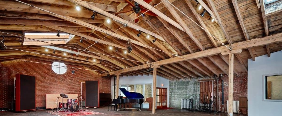Rustic Event Space with Skylights, Natural Wood, and Brick in Philadelphia Hero Image in Germantown, Philadelphia, PA