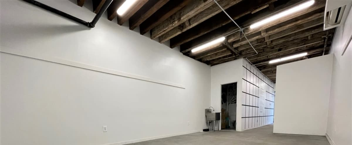 Bright Art Studio with Exposed Wooden Ceiling Beams in Lower East Side in New York Hero Image in Chinatown, New York, NY
