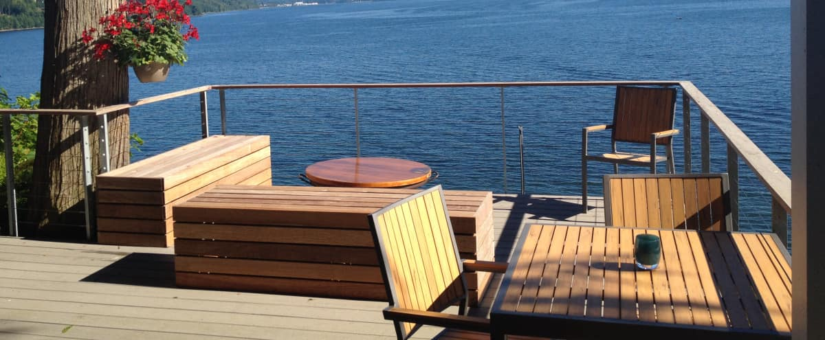 Mid-century ultra-modern Puget Sound view forested beach home just a ferry ride away for downtown Seattle in Bremerton Hero Image in undefined, Bremerton, WA