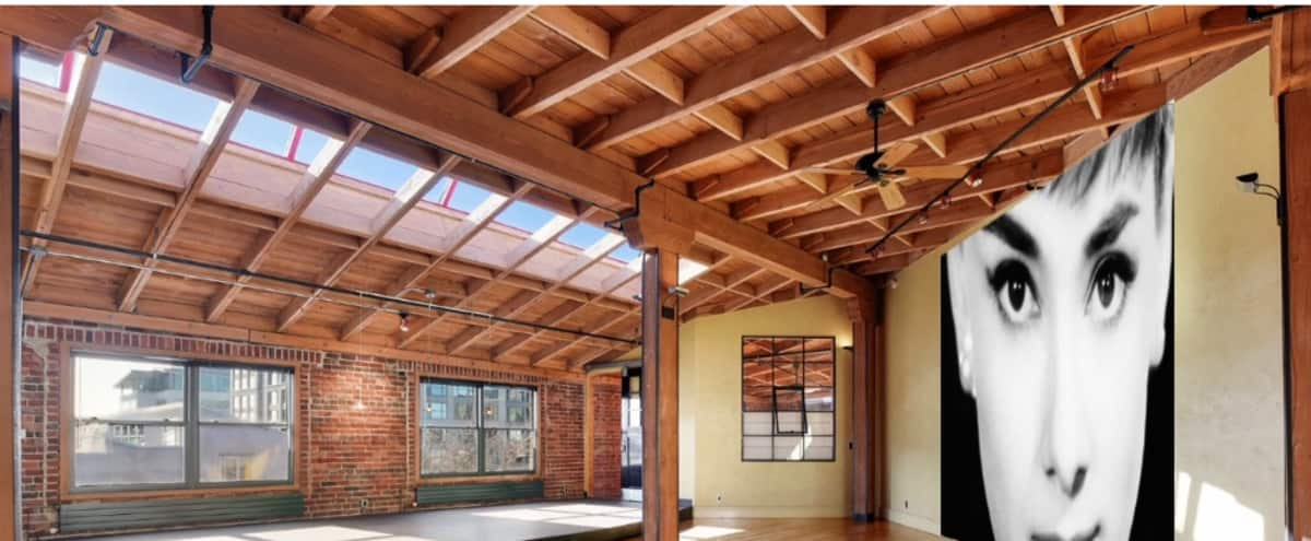 Historic Penthouse Loft: Brick, Beams, Wood Floors, High Ceilings in Oakland Hero Image in Downtown Oakland, Oakland, CA
