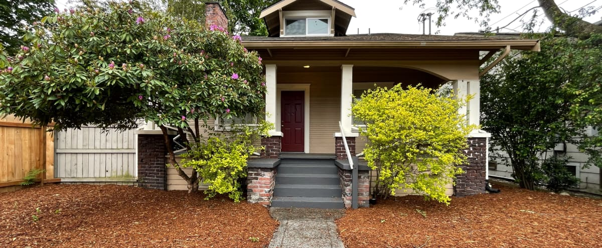 Craftsman Style House with Covered Porch and Fenced Yard in Seattle Hero Image in Greenwood, Seattle, WA
