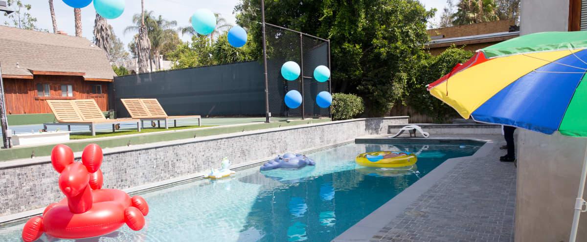 Stone House with Swimming Pool and Tennis Court in Tarzana Hero Image in Tarzana, Tarzana, CA