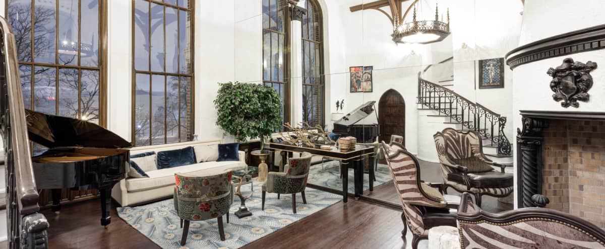 Hyde Park Grand Elegant Victorian Condo w/ Polished Grand Piano, Luxurious Fire Place, & Exquisite Minibar in Chicago Hero Image in Hyde Park, Chicago, IL