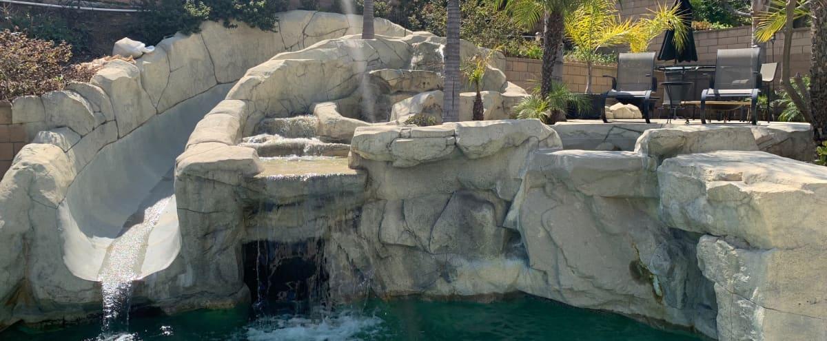 Suburb Rock Pool with Waterfall and Urban Kitchen in Diamond Bar Hero Image in Valle Lindo, Diamond Bar, CA